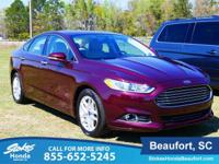 2013 Ford Fusion in Red. Ride is even-tempered. Miles