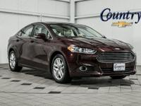 Fusion... SE... Sedan... 1.6 i4... 6-Speed Automatic...