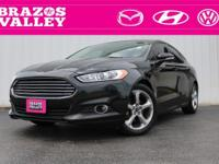 This 2013 Ford Fusion SE was just traded into us, it