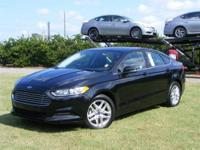 This outstanding example of a 2013 Ford Fusion SE is