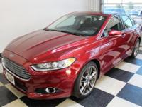 Racy yet refined, this 2013 Ford Fusion turns even the