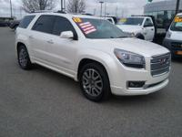 This outstanding example of a 2013 GMC Acadia Denali is