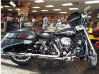 Here is a very rare Anniversary Road King CVO. Stop in