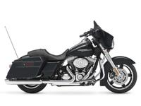 Low miles on this 2013 Street Glide FLHX in midnight