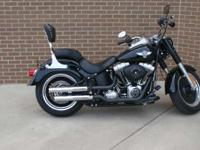 the 2013 Harley-Davidson Fat Boy Lo FLSTFB model has