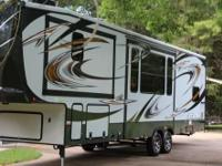 This is a 2013 Heartland Cyclone 3110 HD, Original