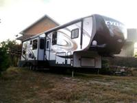 41ft 2013 Cyclone Camper/Toy Hauler. Has 3 slide outs,