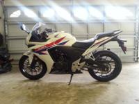 2013 Honda CBR 500R. 1,900 miles, garage kept. Two