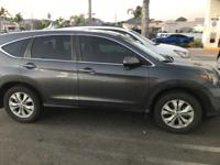 This outstanding example of a 2013 Honda CR-V EX is