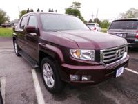 Check out this 2013 Honda Ridgeline RTL. Its Automatic