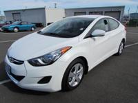 Pearl White Mica exterior and Beige interior, GLS trim.