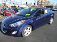 Here's a beautiful. rich blue Elantra. Great miles per