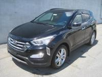 This 2013 Hyundai Santa Fe 2.0T Sport w/Saddle Int is