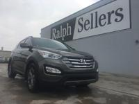 This outstanding example of a 2013 Hyundai Santa Fe