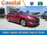 This 2013 Hyundai Sonata Hybrid Limited in Red