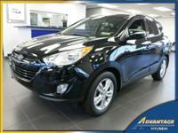 This All Wheel Drive equipped Hyundai Tucson GLS has