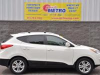 2013 Hyundai Tucson GLS  in Cotton White. 6-Speed