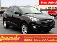 This 2013 Hyundai Tucson Limited in Ash Black features.