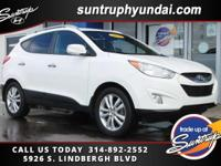 Clean CARFAX. White 2013 Hyundai Tucson AWD 6-Speed