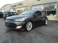 Step into the 2013 Hyundai Veloster! It offers great