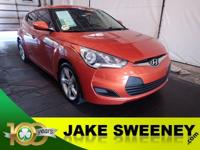 Our 2013 Hyundai Veloster is outstanding in Orange! You