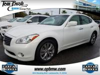 This outstanding example of a 2013 Infiniti M37 is