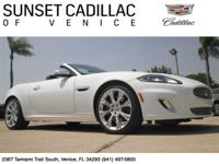 Convertible Jaquar XK. Equipped with Navigation, a