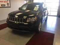 This 2013 Jeep Compass Sport in Black / Forest Green