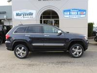This 2013 Jeep Grand Cherokee Overland 5.7 Hemi Clean