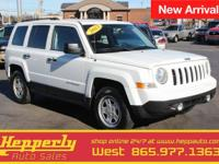 This 2013 Jeep Patriot Sport in Bright White Clearcoat