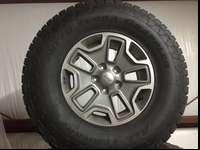 5 original Jeep Rubicon wheels and Nitto radial tires.