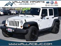 Clean CARFAX. White 2013 Jeep Wrangler Unlimited Sport