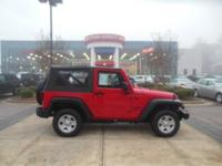 This is a 2013 Jeep Wrangler Sport that is Flame Red