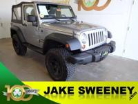 Our 2013 Jeep Wrangler 4WD in Gray is ready to handle