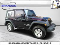 This outstanding example of a 2013 Jeep Wrangler Sport
