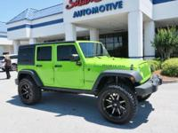This 2013 Jeep Wrangler Unlimited  has a 3.6 liter V6