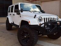 This Jeep Wrangler Unlimited Sahara 4WD 5-Speed