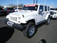 This 2013 Jeep Wrangler Unlimited Sahara is proudly