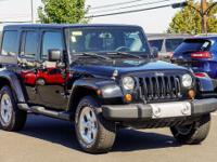 Clean CARFAX. Black 2013 Jeep Wrangler Unlimited Sahara