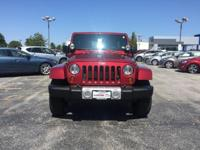 2013 Jeep Wrangler Unlimited Sahara in Deep Cherry Red