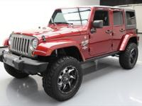 This awesome 2013 Jeep Wrangler 4x4 comes loaded with
