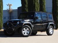 We are excited to offer this 2013 Jeep Wrangler