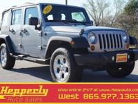 This 2013 Jeep Wrangler Unlimited Sport in Anvil Clear
