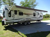 This travel trailer is a 1/2 ton towable, rear living