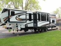"2013 36'5"" Fuzion 315 Fifth Wheel Toy Hauler sets up in"