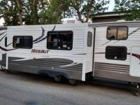 Like new, 28 foot, heated and enclosed underbelly,