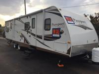 This is a very clean 2013 Keystone Passport Ultra Lite