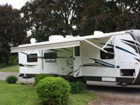2013 Keystone Outback 298RE Travel Trailer. Length