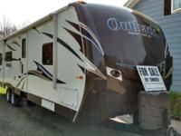 BY OWNER - This seldom used 29' travel trailer with