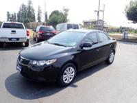 Treat yourself to this 2013 Kia Forte EX, which